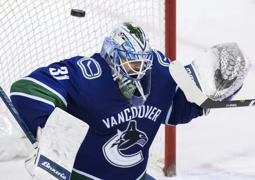 Vancouver Canucks goalie Anders Nilsson, of Sweden, allows a goal to Minnesota Wild's Jason Zucker during the second period of an NHL hockey game in Vancouver, British Columbia, Tuesday Dec. 4, 2018. (Darryl Dyck/The Canadian Press via AP)