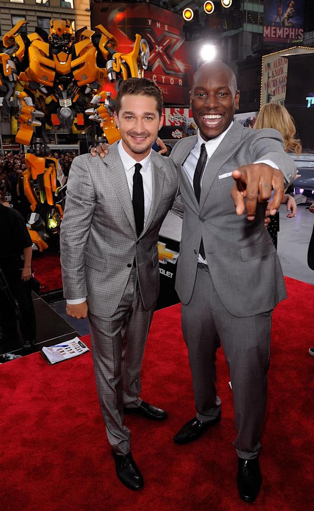 <p>LaBeouf and Gibson are matchy-matchy on the <em>Dark of the Moon</em> red carpet. (Photo: Jemal Countess/Getty Images) </p>