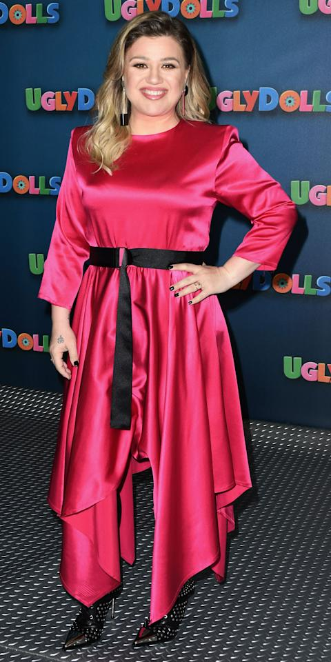 <p>Kelly Clarkson paired a hot pink dress with studded boots while promoting her new film <em>UglyDolls</em>.</p>