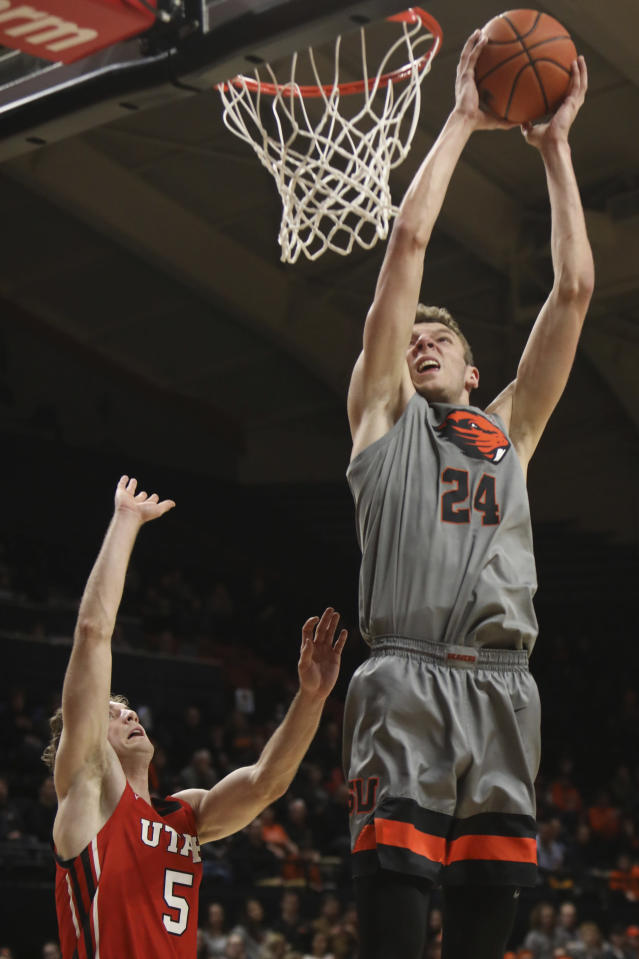 Oregon State's Kylor Kelley (24) shoots over Utah's Jaxon Brenchley (5) during the first half of an NCAA college basketball game in Corvallis, Ore., Thursday, Feb. 13, 2020. (AP Photo/Amanda Loman)