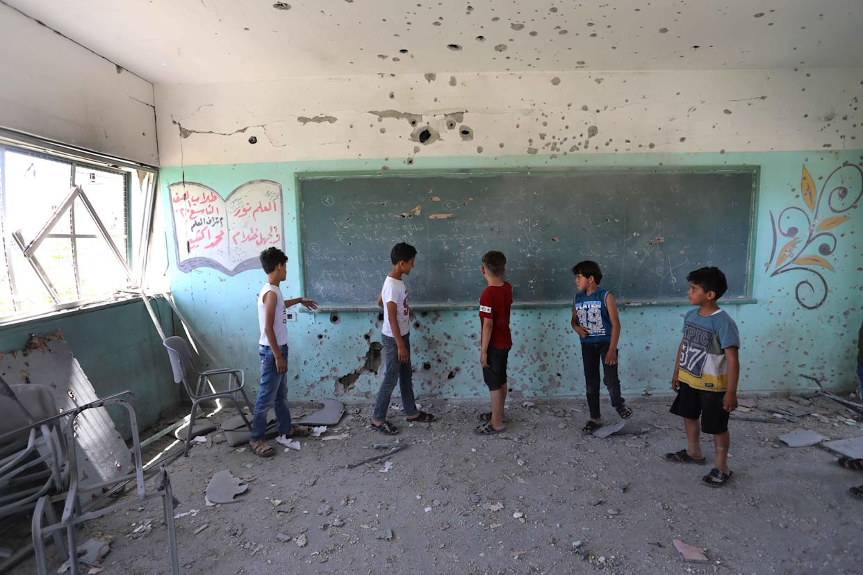 GAZA CITY, GAZA - MAY 26: Children are seen inside a damaged school in the aftermath of Israeli attacks that began on May 10 and continued for 11 days in Gaza City, Gaza on May 26, 2021. According to Palestinian Education and Training Ministry total of 187 schools were damaged including 55 pre-schools were damaged in the attacks. (Photo by Ashraf Amra/Anadolu Agency via Getty Images)