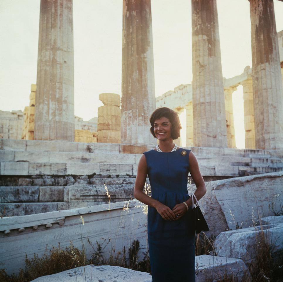 <p>Jackie's stone looked gorgeous with a deep teal dress while touring the Acropolis in 1961.</p>