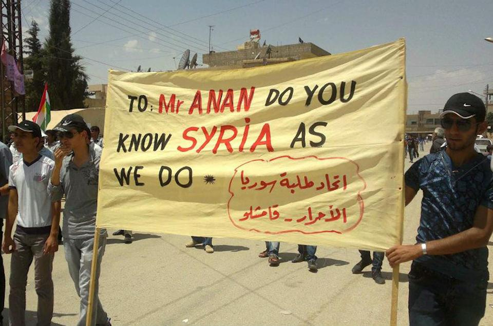 """This citizen journalism image provided by Shaam News Network SNN purports to show anti-Syrian regime protesters holding a banner during a demonstration called the """"Friday of Russia is the enemy of Syrian people,"""" at the northeastern town of Qamishli, Syria, Friday, June 15, 2012. (AP Photo/Shaam News Network, SNN)THE ASSOCIATED PRESS IS UNABLE TO INDEPENDENTLY VERIFY THE AUTHENTICITY, CONTENT, LOCATION OR DATE OF THIS HANDOUT PHOTO"""