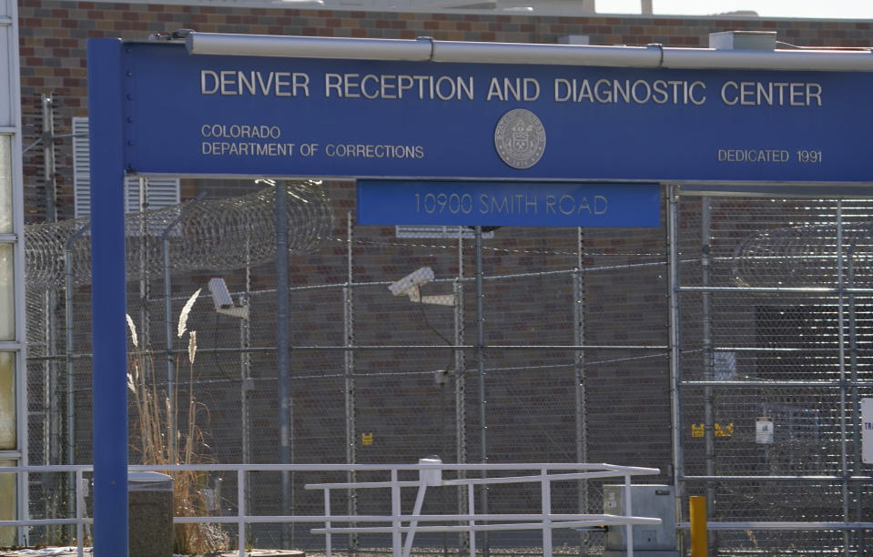 The front gate to the Denver Reception and Diagnostic Center operated by the Colorado Department of Corrections is shown Tuesday, Dec. 8, 2020, in east Denver. Amber Johnson of Fayetteville, Ark., is fighting to have her 63-year-old father, Ronald, who is an inmate in the prison, to be vaccinated against COVID-19 along with the rest of the prisoners to protect against future outbreaks. (AP Photo/David Zalubowski)