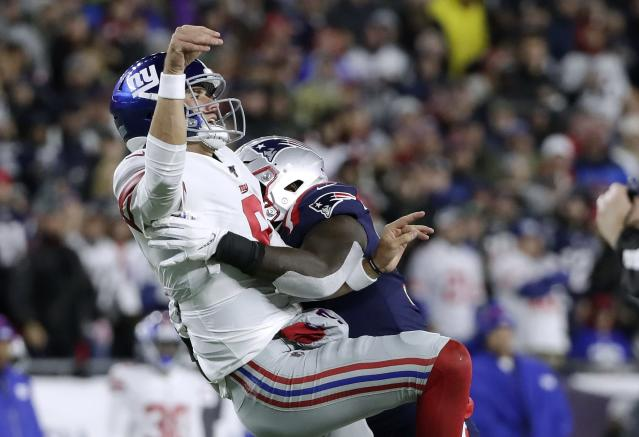 New England Patriots linebacker Ja'Whaun Bentley, right, hits New York Giants quarterback Daniel Jones after he released a pass in the second half of an NFL football game, Thursday, Oct. 10, 2019, in Foxborough, Mass. (AP Photo/Elise Amendola)