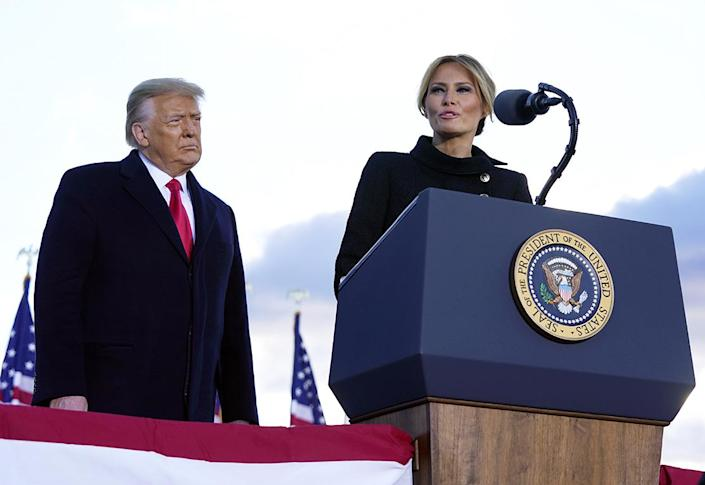 <p>President Donald Trump listens as First Lady Melania Trump speaks before boarding Air Force One. </p>