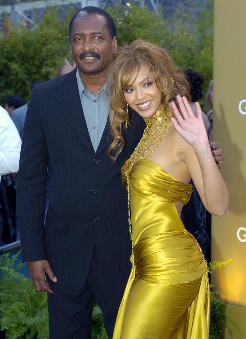 "FILE - In this Feb. 8, 2004 file photo, singer Beyonce Knowles arrives at the 46th Annual Grammy Awards with her father and manager Mathew Knowles in Los Angeles. Mathew Knowles says his relationship with his superstar daughter Beyonce is still ""amicable,"" but he's alleging people close to her of trying to destroy his reputation with allegations of theft. (AP Photo/Mark J. Terrill, file)"