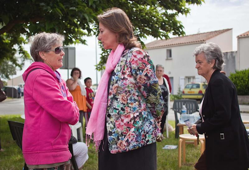 French former Socialist presidential candidate Segolene Royal , centre, campaigns in Villeneuve-les Salines near La Rochelle, west of France, Thursday, June 14, 2012. Royal is facing a Socialist Party opponent in the second round election next Sunday. (AP Photo/Yohan Bonnet)