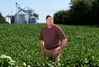 FILE PHOTO: Farmer Doug Zink stands in one of his soybean fields near Carrington, North Dakota