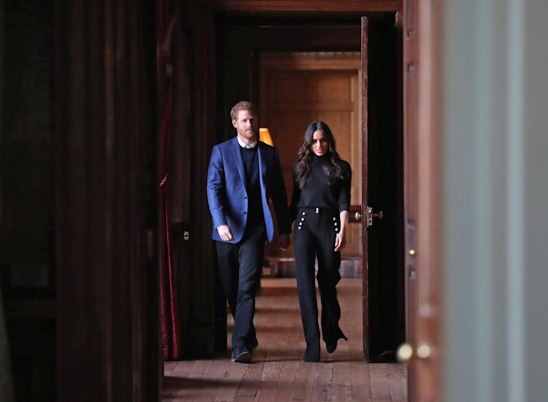EDINBURGH, SCOTLAND - FEBRUARY 13: Prince Harry and Meghan Markle walk through the corridors of the Palace of Holyroodhouse on their way to a reception for young people at the Palace on February 13, 2018 in Edinburgh, Scotland. (Photo by Andrew Milligan - WPA Pool/Getty Images)