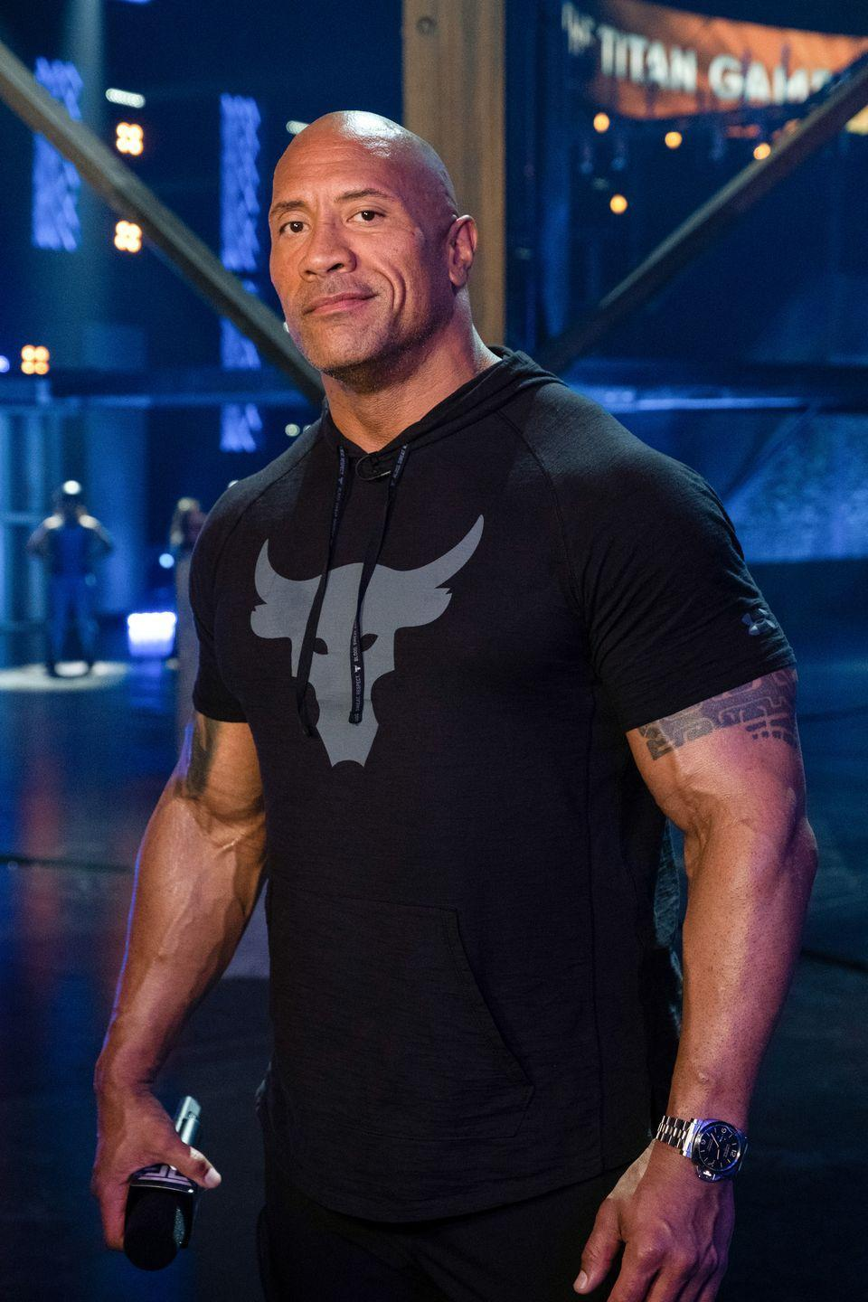 """<p>Still looking like he did back in his WWE days, Johnson has expanded his career to include <a href=""""https://www.menshealth.com/entertainment/g32336205/the-titan-games-contestants-season-2/"""" rel=""""nofollow noopener"""" target=""""_blank"""" data-ylk=""""slk:producing television shows"""" class=""""link rapid-noclick-resp"""">producing television shows</a> and <a href=""""https://www.menshealth.com/entertainment/g32842774/40-celebrities-business-moguls/"""" rel=""""nofollow noopener"""" target=""""_blank"""" data-ylk=""""slk:launching"""" class=""""link rapid-noclick-resp"""">launching</a> his own tequila. </p>"""