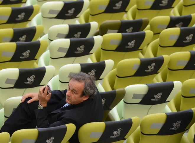 UEFA president Michel Platini looks on at the end of the Euro 2012 championships football match Spain vs Italy on June 10, 2012 at the Gdansk Arena.     AFP PHOTO/ PATRIK STOLLARZPATRIK STOLLARZ/AFP/GettyImages