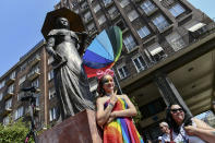 People taking part in a gay pride parade pose before the start of the event in Budapest, Hungary, Saturday, July 24, 2021. Hungary's government led by right-wing Prime Minister Viktor Orban passed a law in June prohibiting the display of content depicting homosexuality or gender reassignment to minors, a move that has ignited intense opposition in Hungary while EU lawmakers have urged the European Commission to take swift action against Hungary unless it changes tack. (AP Photo/Anna Szilagyi)