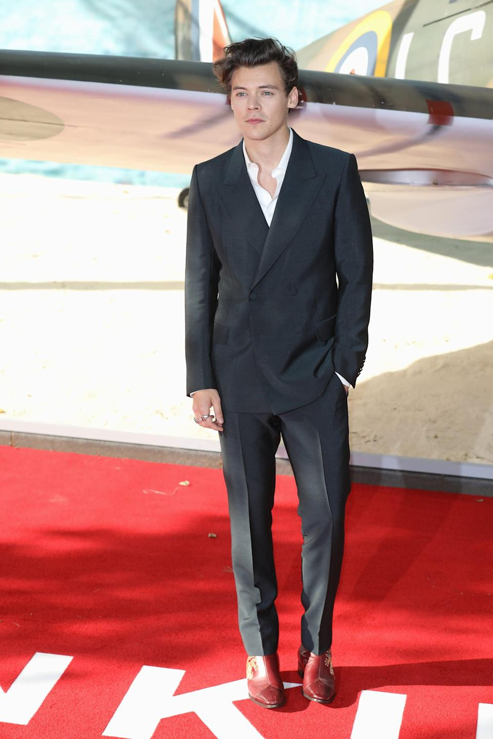 <p>At the premiere for <strong>Dunkirk</strong> in 2017 wearing red Gucci boots embroidered with dragons.</p>