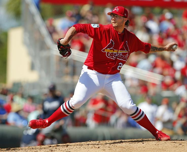 Brett Cecil of the St. Louis Cardinals delivers a pitch during a spring training game against the Atlanta Braves, at Roger Dean Stadium in Jupiter, Florida, on March 11, 2017