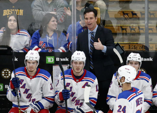 FILE - In this Jan. 19, 2019, file photo, New York Rangers coach David Quinn gestures from the bench during the third period of the team's NHL hockey game against the Boston Bruins in Boston. The Rangers head into their first practice of training camp with the belief they are ready to take the next step in the second year under Quinn. (AP Photo/Mary Schwalm, File)