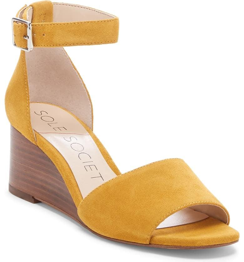 """<p>Add some color to your outfit with these <a href=""""https://www.popsugar.com/buy/Sole%20Society%20Kenia%20Wedge%20Sandals-462585?p_name=Sole%20Society%20Kenia%20Wedge%20Sandals&retailer=shop.nordstrom.com&price=48&evar1=fab%3Aus&evar9=46309250&evar98=https%3A%2F%2Fwww.popsugar.com%2Ffashion%2Fphoto-gallery%2F46309250%2Fimage%2F46309382%2FSole-Society-Kenia-Wedge-Sandals&list1=shopping%2Csandals%2Cshoes%2Csummer%2Csummer%20fashion%2Caffordable%20shopping&prop13=mobile&pdata=1"""" rel=""""nofollow"""" data-shoppable-link=""""1"""" target=""""_blank"""">Sole Society Kenia Wedge Sandals</a> ($48, originally $80).</p>"""
