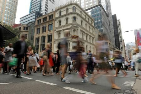Office workers walk the streets of Sydney, Australia