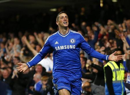 Chelsea's Fernando Torres celebrates scoring a goal against Manchester City during their English Premier League soccer match at Stamford Bridge in London