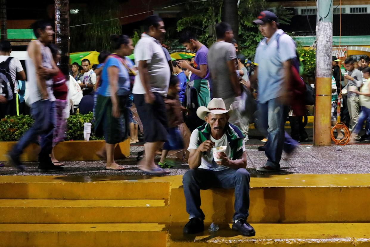 A Honduran migrant drinks soup during a new leg of their travel in Tecun Uman, Guatemala, on Oct. 18, 2018.