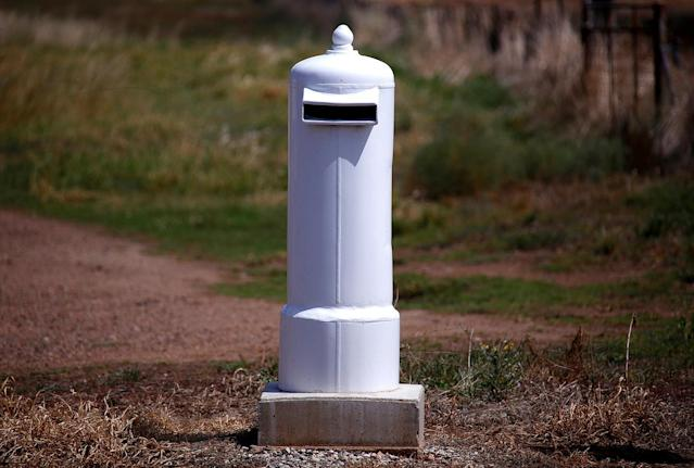 <p>An old cylinder previously used to cover an electricity box has been converted into a mailbox in the outskirts of Gunnedah township, northwest of Sydney, Australia. (Photo: David Gray/Reuters) </p>