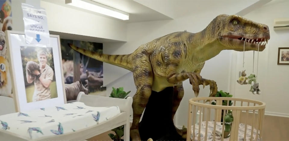A T-rex looms over baby Grace's cot courtesy 'funcle' - that's 'fun uncle' - Robert Irwin. Photo: Animal Planet.