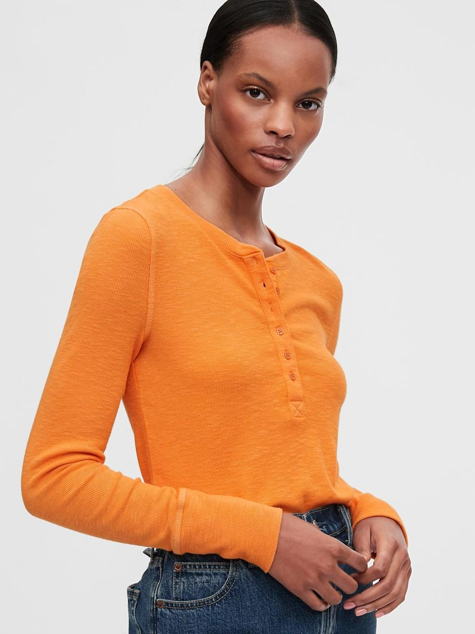 <p>Wear this soft <span>Gap Ribbed Henley T-Shirt</span> ($31, originally $40) fully buttoned or slightly opened with a cascade of layering necklaces for a cool girl effect.</p>