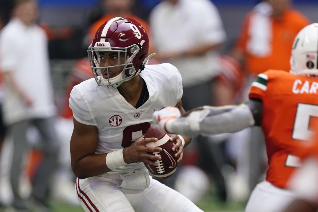 Alabama quarterback Bryce Young (9) looks for an open receiver under pressure from the Miami defense during the second half of an NCAA college football game Saturday, Sept. 4, 2021, in Atlanta. (AP Photo/John Bazemore)