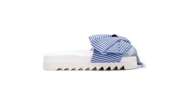 "<p>Bow striped pool slides, $268, <a href=""https://www.farfetch.com/shopping/women/joshua-sanders-bow-striped-pool-slides-item-11994980.aspx?storeid=9334&from=search&ffref=lp_pic_164_47_"" rel=""nofollow noopener"" target=""_blank"" data-ylk=""slk:farfetch.com"" class=""link rapid-noclick-resp"">farfetch.com</a> </p>"
