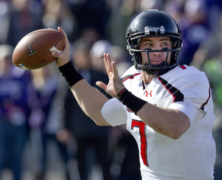 Texas Tech quarterback Seth Doege throws a pass during the first half of an NCAA college football game against Kansas State in Manhattan, Kan., Saturday, Oct. 27, 2012. (AP Photo/Orlin Wagner)