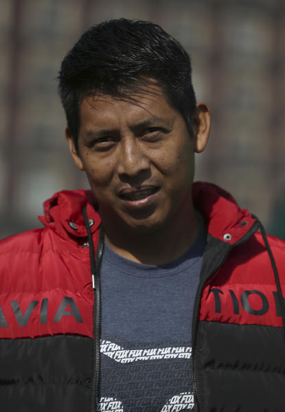 Damian Banuelos poses for a photo during an interview in the Zocalo in Mexico City, Friday, Nov. 29, 2019.  Banuelos is a Huichol artisan from the mountains of Nayarit, a state on the Pacific coast, who feels that the Mexican president is far more accessible and in touch with the people than his predecessors. (AP Photo/Marco Ugarte)