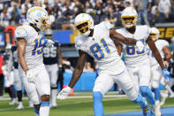 Los Angeles Chargers wide receiver Mike Williams (81) celebrates his touchdown catch with Jalen Guyton (15) during the first half of an NFL football game against the Dallas Cowboys Sunday, Sept. 19, 2021, in Inglewood, Calif. (AP Photo/Gregory Bull)