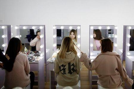 Girls attend make-up training session at live streaming talent agency Three Minute TV, in Beijing, China, February 15, 2017. Picture taken February 15, 2017. REUTERS/Thomas Peter