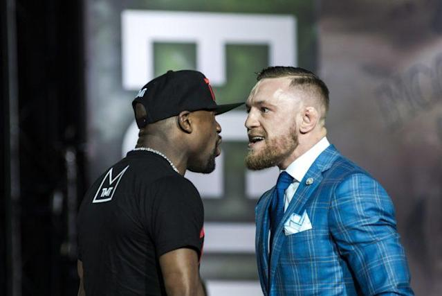 Floyd Mayweather Jr. and Conor McGregor face off during a news conference last week in Toronto to promote their Aug. 26 boxing match at T-Mobile Arena in Las Vegas. (The Canadian Press)