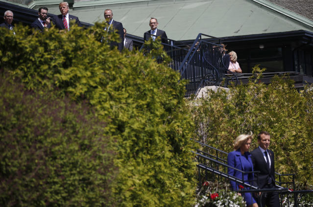 <p>President Donald Trump looks down a hill past France's President Emmanuel Macron as Macron arrives with his wife Brigitte just ahead of Trump at the G7 Summit in Charlevoix, Quebec, Canada, June 8, 2018. (Photo: Leah Millis/Reuters) </p>