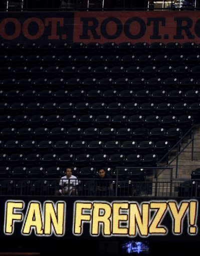 There are few fans and no frenzy in this section of the ballpark during the third inning of a Houston Astros baseball game against the Chicago Cubs Wednesday, Sept. 12, 2012, in Houston. (AP Photo/Pat Sullivan)