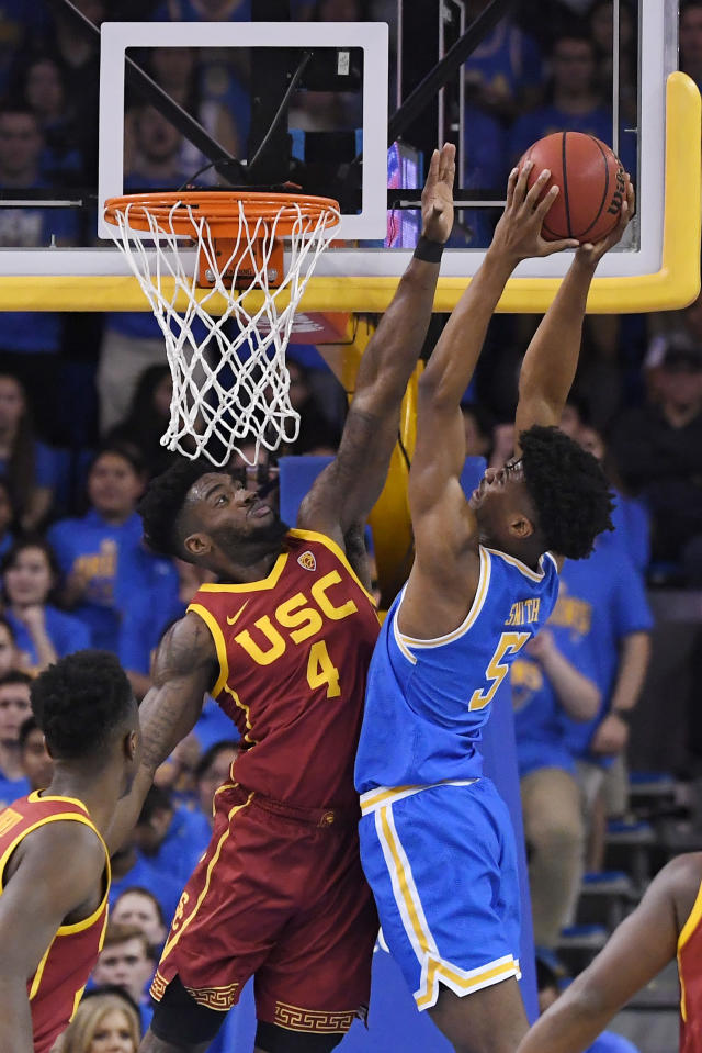 UCLA guard Chris Smith, right, goes up for a shot as Southern California guard Daniel Utomi defends during the first half of an NCAA college basketball game Saturday, Jan. 11, 2020, in Los Angeles. (AP Photo/Mark J. Terrill)