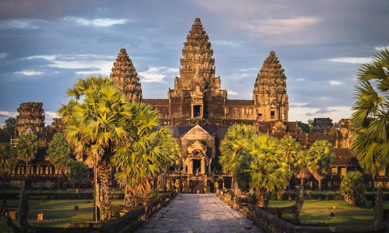 Sunset at Angkor Wat in Cambodia where dinner can be taken in an ancient Hindu temple during a round the world tour next month.