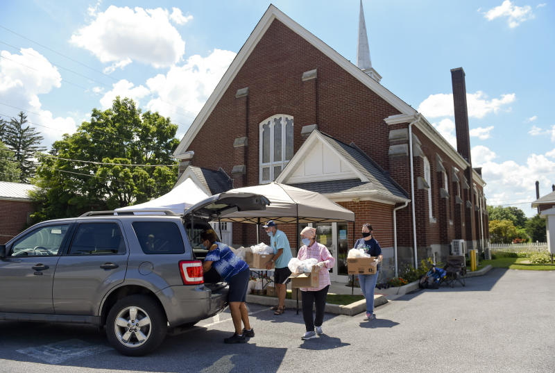 Volunteers load up boxes of food to take to a Franklin and Noble Manor, a nearby senior apartment building. They had a lower than expected turnout, so they checked and found that there were residents there who could use food. During a food distribution at the Salem United Methodist Church in Shoemakersville, PA Wednesday afternoon July 15, 2020. (Photo by Ben Hasty/MediaNews Group/Reading Eagle via Getty Images)