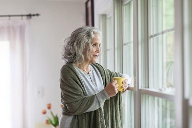 Senior woman looking out of window