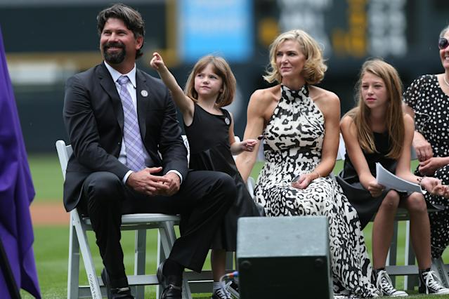 From left, retired Colorado Rockies first baseman Todd Helton is joined by his daughter Gentry Grace, wife Christy and oldest daughter Tierney Faith during a ceremony at which the player's number was retired as the Rockies host a baseball game in Denver on Sunday, Aug. 17, 2014. (AP Photo/David Zalubowski)