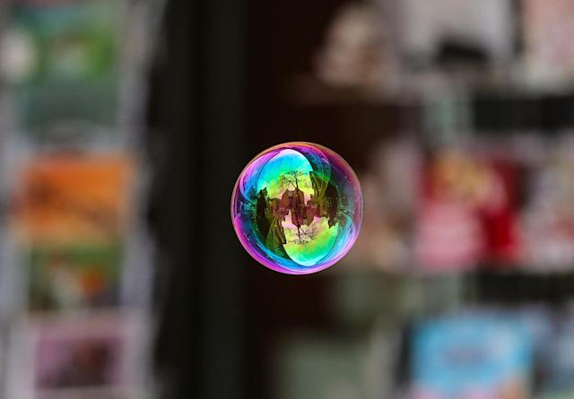 <p>A soap bubble released by a child, reflects the city hall of Frankfurt at Roemerberg Square in Frankfurt Main, Germany, May 5, 2017. (Photo: Armando Babani/EPA) </p>