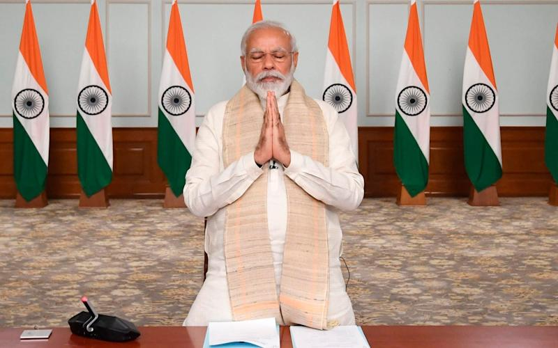 Indian Prime Minister Narendra Modi pays tribute to Indian soldiers killed during confrontation with Chinese soldiers in the Ladakh region - India Government Press Information Bureau via AP