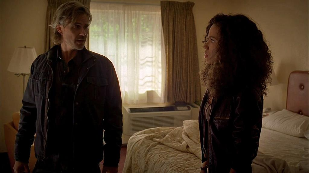 "Sam Trammell and Jurnee Smollett-Bell in the ""True Blood"" Season 6 episode, ""In the Evening."""