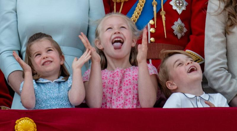 Princess Charlotte and Prince George on the balcony of Buckingham Palace with their cousin, Savannah Phillips