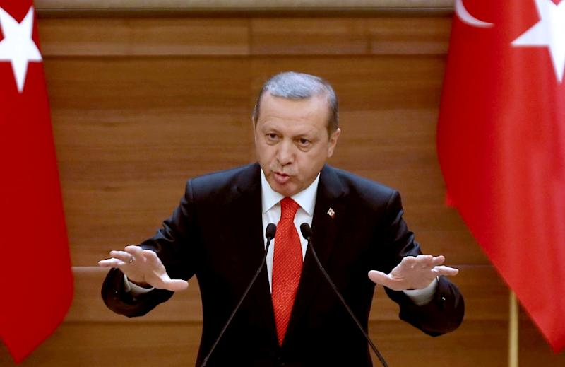 Turkish President Recep Tayyip Erdogan says Ankara will not tolerate any military build-up near its border with Syria (AFP Photo/Adem Altan)
