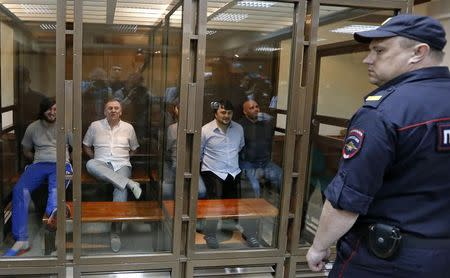 Defendants in the murder trial of Russian journalist and human rights activist Anna Politkovskaya attend a court hearing in Moscow