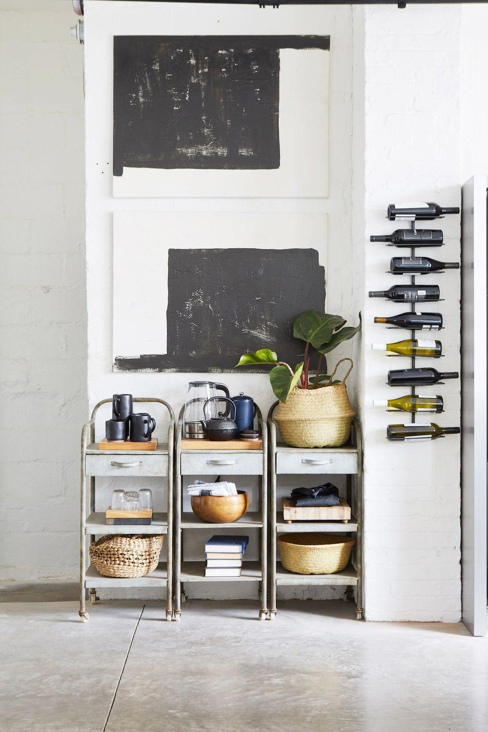 """<p>No space, no problem. Use a wall unit like this one in a kitchen designed by <a href=""""https://leanneford.com/"""" rel=""""nofollow noopener"""" target=""""_blank"""" data-ylk=""""slk:Leanne Ford Interiors"""" class=""""link rapid-noclick-resp"""">Leanne Ford Interiors</a>. And there's a reason they bottles are organized horizontally: storing them like this keeps oxygen from slipping in through the cork. </p>"""