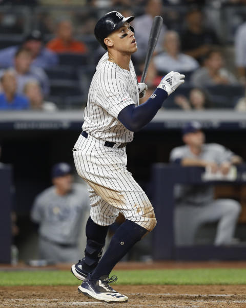 New York Yankees' Aaron Judge watches his two-run home run in the eighth inning of the team's baseball game against the Tampa Bay Rays, Tuesday, July 16, 2019, in New York. (AP Photo/Kathy Willens)