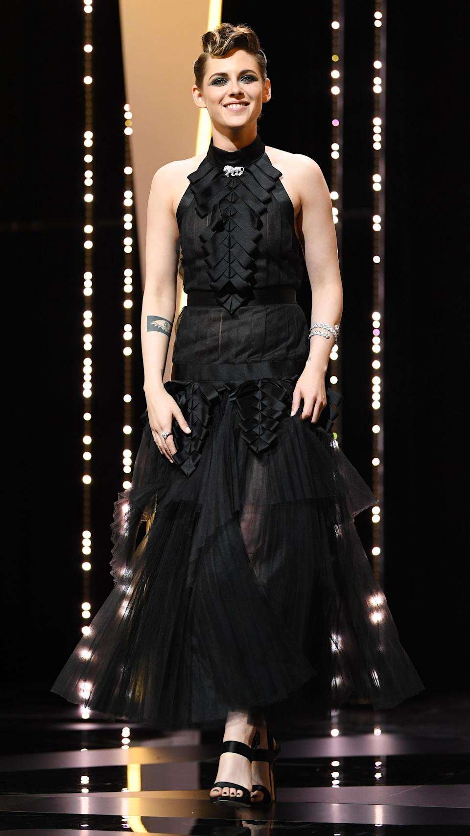 <p>Kristen Stewart attended the screening for 'Everybody Knows' wearing a Chanel autumn/winter 2018 dress, wearing her hair in a decorative quiff. <em>[Photo: Getty]</em> </p>